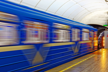 Background of motion blur of speed train in the subway. Underground vehicle dynamic motion