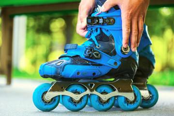 Roller adjusting buckle on inline roller skates.