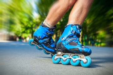 Closeup of Inline roller skater on a slalom course.