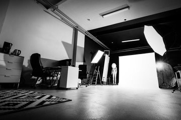 Photo studio interior with lighting equipment.