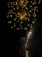 Celebration fireworks over night sky copy space. Celebration colorful fireworks. Beautiful fireworks. Holidays salute.  Independence Day. New Year. Yellow firework. Amazing fireworks, fireworks 2017