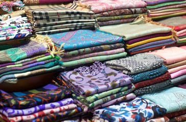 Istanbul, Turkey. Fabrics and scarves for sale at a market stall