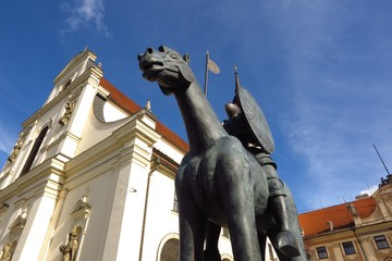 Equestrian Statue of Margrave Jobst of Luxembourg astride a horse in front of Church of St. Thomas in Brno, Czech Republic, Southern Moravia