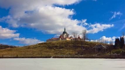 UNESCO Pilgrimage Church of St John of Nepomuk in Zdar nad Sazavou, Czech Republic across frozen lake on hilltop