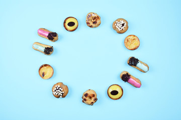 Delicious various pastries on blue background.