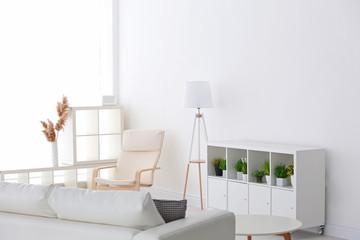 Stand for TV set in modern white living room