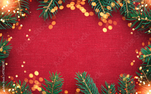 Christmas Background With Xmas Tree And Sparkle Bokeh Lights On Red