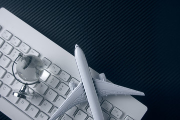 airplane with global world and keyboard in business vision concept