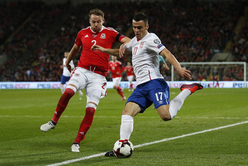 Serbia's Filip Kostic in action with Wales' Chris Gunter