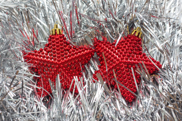 Christmas decorations Two red stars., sparking, glowing. Merry Christmas and Happy New Year 2018. Xmas card