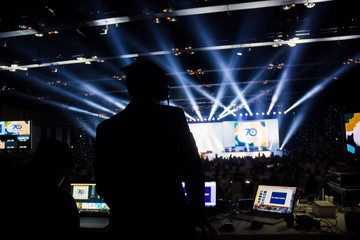 Silhouette of worker control, sound system and lighting in concert.