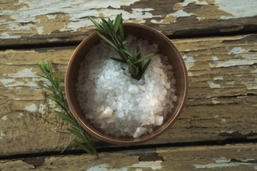 Salt and rosemary herb in bowl