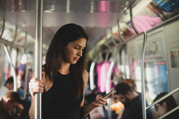 Woman on subway train in New York City