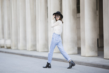 Fashionable young woman walking on the street