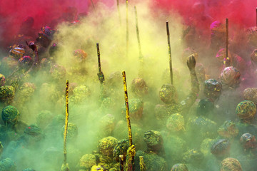 Holi Festival with colored powder spread in air