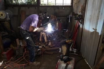 Metal worker in studio working
