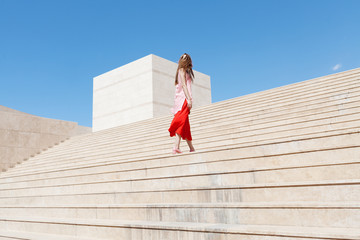 woman with red and pink clothes on the stairs