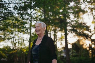 Happy caucasian senior woman smiling outside