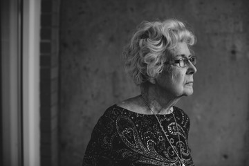 Thoughtful portrait of senior caucasian woman outside