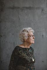Thoughtful portrait of senior caucasian woman outside