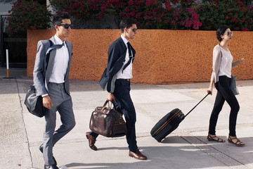 Young entrepreneurs leavint the airport