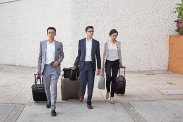 Young entrepreneurs walking outside airport
