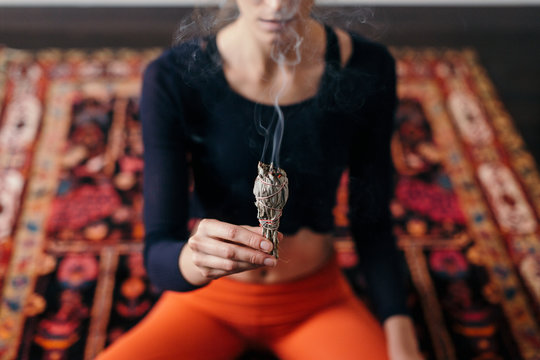 Woman with incense stick in hand