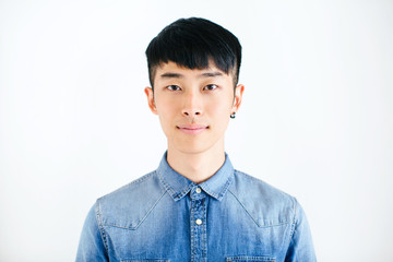 South Korean man standing over white background.
