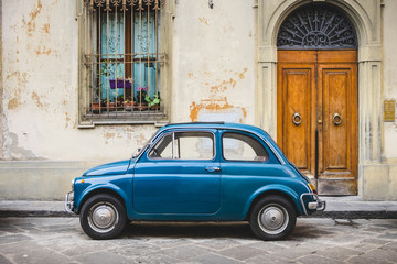 Small Italian Vintage Car Parked in Tuscan Alley