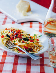 Spaghetti with sauce, olives and capers
