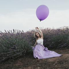 Artistic photo of a young woman in lavender