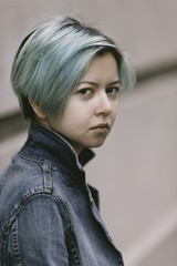 portrait of young woman with green hair