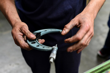 A mechanic holding a tool on a workshop