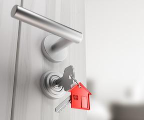 Portachiavi a forma di casa nella serratura
