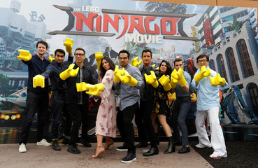 """Cast members Woods, Nanjiani, Armisen, Munn, Pena, Theroux, Jacobson, Franco and Chan pose during a photo call for """"The LEGO Ninjago Movie"""" at Legoland California in Carlsbad"""