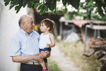 Grandfather with his grandson outdoor