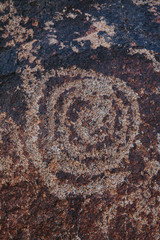 Close up of prehistoric petroglyph carvings on rock formations