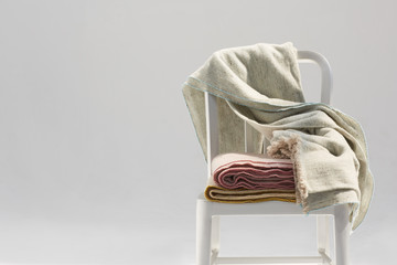 Set of handmade wool blankets on a metallic chair