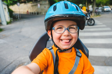 Toddler with Helmet on Rear Seat of a Bicycle, Child Safety