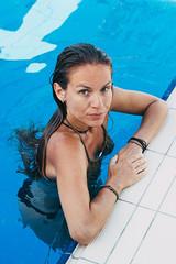 Young female model in the swimming pool
