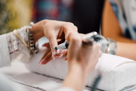 The process of manicure at a beauty salon