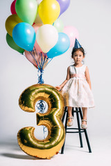 Adorable little girl at her three years birthday party