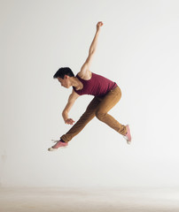 Young asian male dancer mid-air