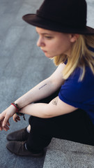 Close up of urban woman with tattoos