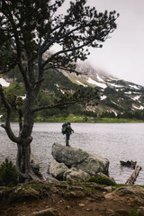 Lake fishing in the mountain in a stormy day