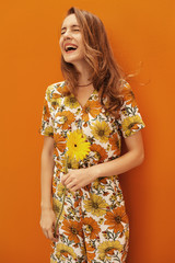 Smiling young woman holding a sunflower