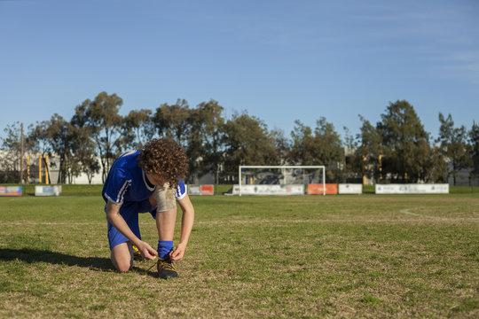 Teen boy preparing for football game
