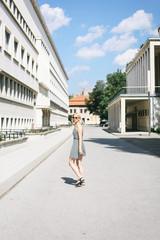 Blonde woman in a dress walking