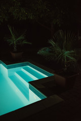 View of an outdoor pool at night
