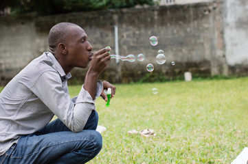 man playing with soap bubbles